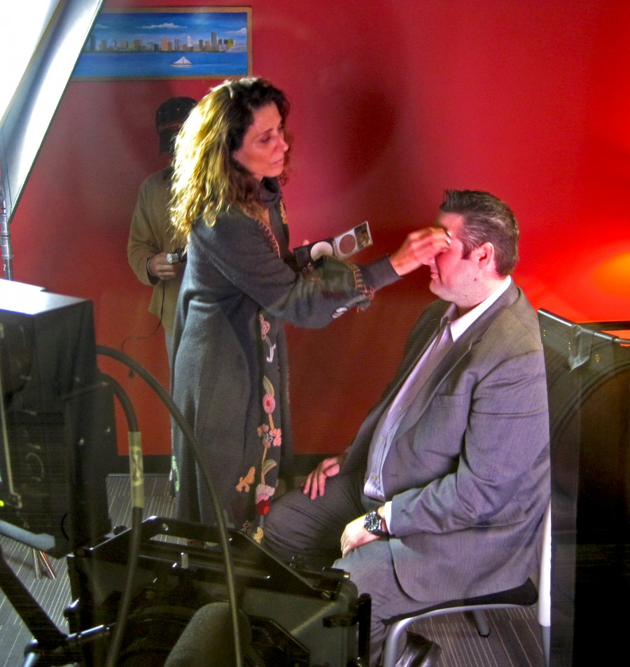 St Louis Video Production, Make-up artist getting talent ready for filming.